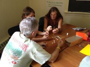 Teachers working on the marshmallow challenge